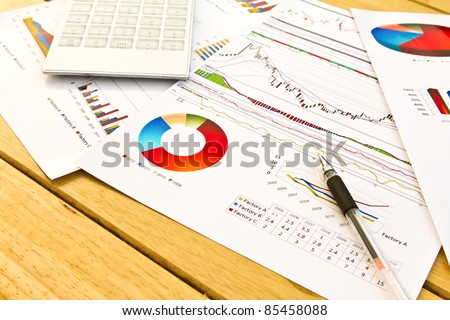 Pen and business graph - stock photo