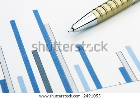 pen and charts  (business concept,focus point on the pen)