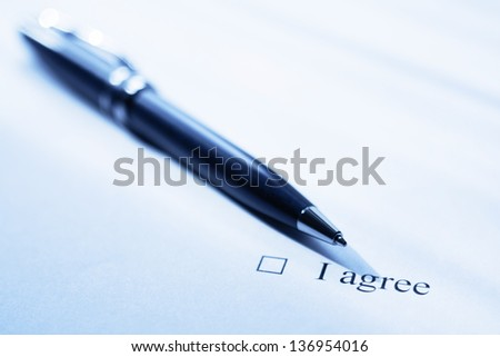 Pen and clause of an agreement. Blue color tone. - stock photo