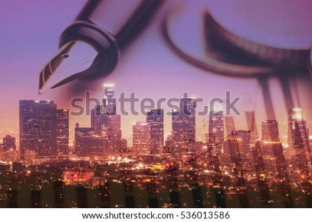 Pen and currency on town background.