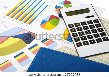 Pen and diagrams. Finance and accounting business. - stock photo