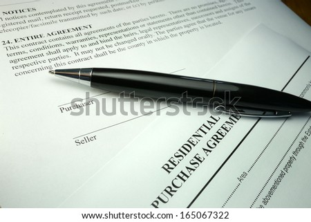 pen and legal documents for buying a house