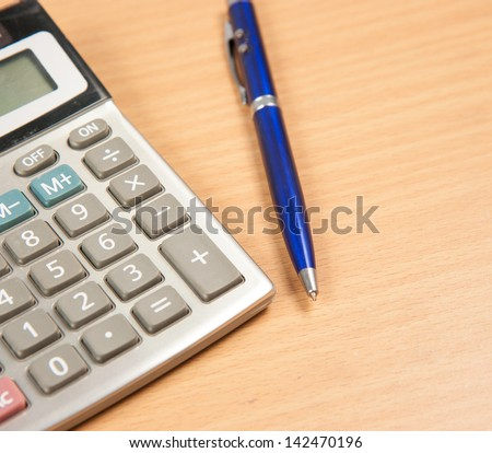 pen and notebook on the wood table - stock photo