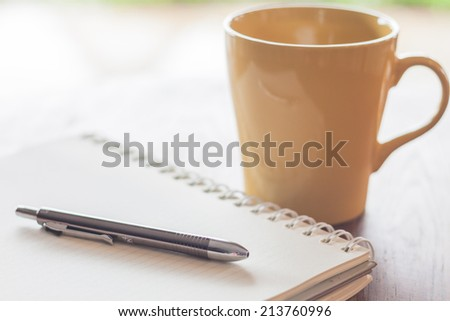 Pen and notebook with coffee mug, stock photo - stock photo