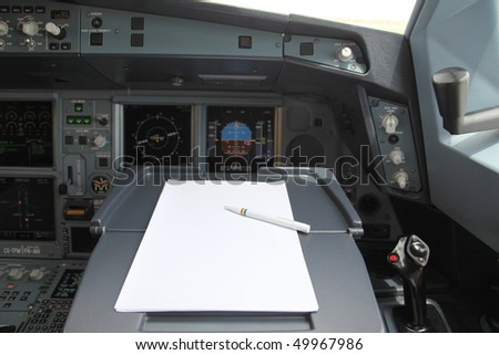 pen and paper in cockpit - stock photo