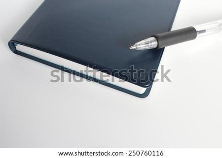 pen and pocket diary - stock photo
