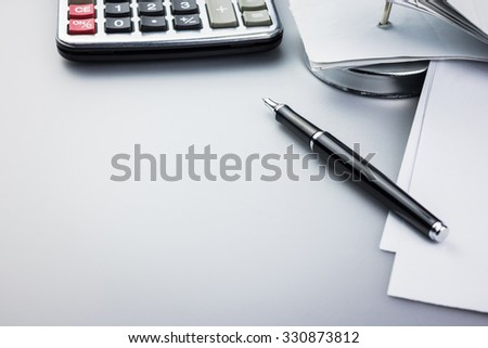 Pen and receipts with space for text - stock photo