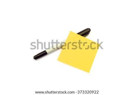 Pen and yellow memo paper - stock photo