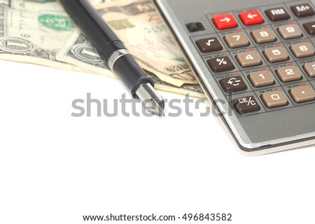 Pen, calculator and United States currency, finance concept