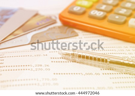 pen ,calculator, credit card on account book. selective focus and vintage tone - stock photo