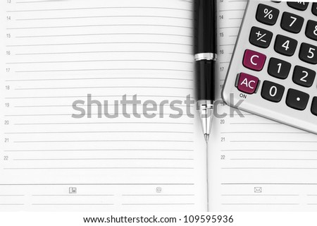 Pen, calculator on notebook close up with space for text - stock photo