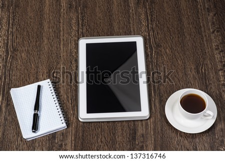pen, coffee and tablet on the table, workplace businessman