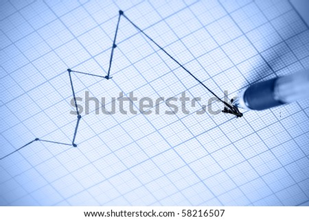 Pen drawing a crisis graph. Shallow DOF! - stock photo