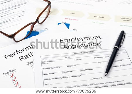 Pen, Glasses and Employment Application Form on desktop in business office. - stock photo