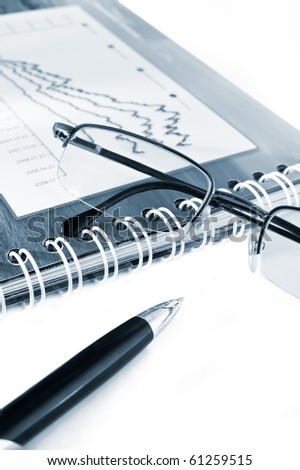 Pen, Glasses and stats on a white background. - stock photo