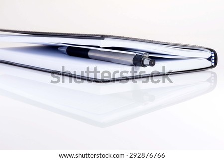 Pen in a book - stock photo