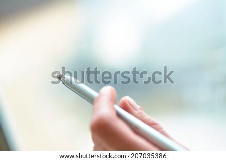 Pen in hand - stock photo