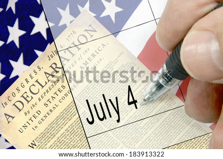 Pen-in-hand calendar notation of United States holiday, Independence Day, Fourth of July, July 4, American flag, floral display, and national cemetery in background.