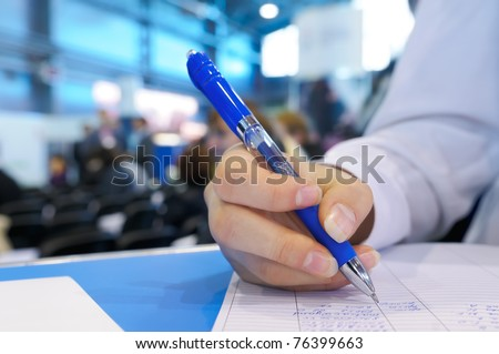 Pen in the female hand - fill in a form. - stock photo
