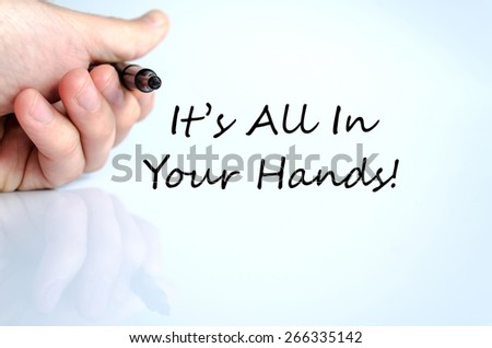 Pen in the hand isolated over white background and text concept It's all in your hand - stock photo
