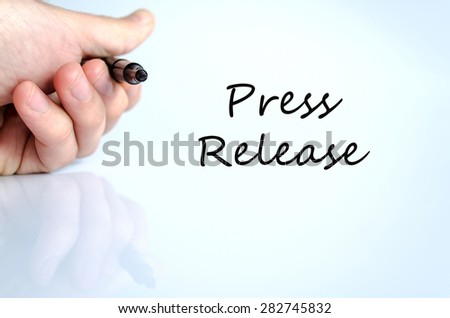 Pen in the hand isolated over white background press release - stock photo
