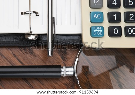 pen, magnifying glass and the diary - stock photo