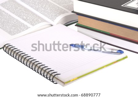 Pen, notebook and books - stock photo