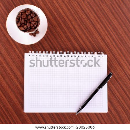 Pen,notebook  and coffee on wooden background - stock photo