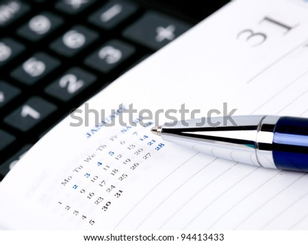 Pen,  notebook page and calculator. macro - stock photo