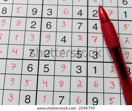 Pen on a sudoku grid.