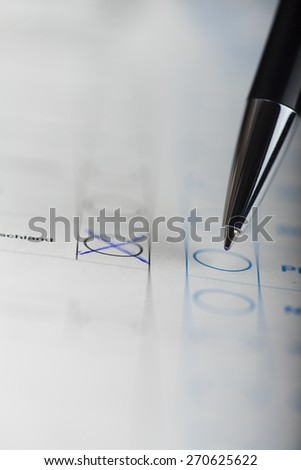 pen on an election form  - stock photo