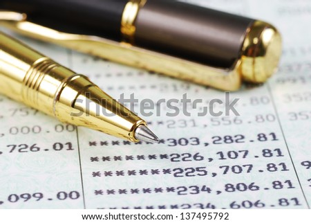 Pen on bank account book