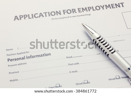 pen on business document application form. - stock photo