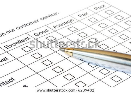 Pen on customer service rating. - stock photo