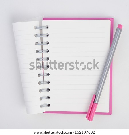 Pen on Face purple notebook for background and text  - stock photo