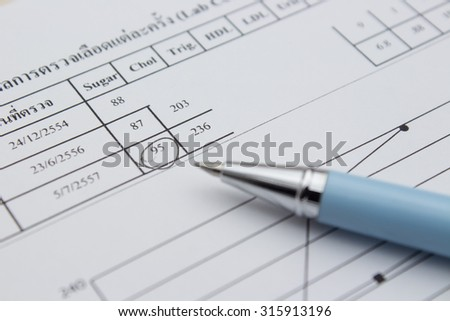 pen on medical check report background