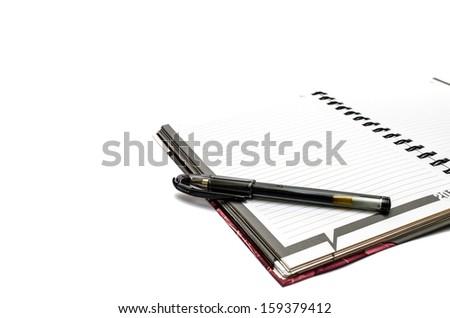 Pen on notebook - stock photo