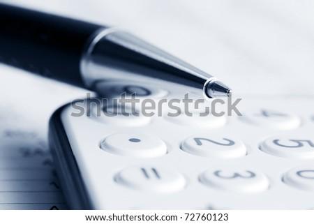 Pen on the calculator - stock photo