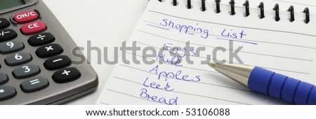 Pen on the handwriting shopping list. isolated on white background. - stock photo