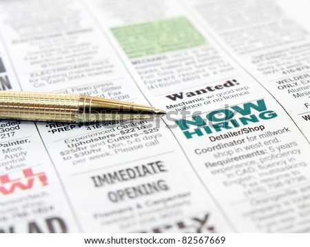 Pen on the newspaper career opportunity ad. - stock photo