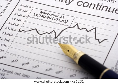 Pen Over Chart close up - stock photo
