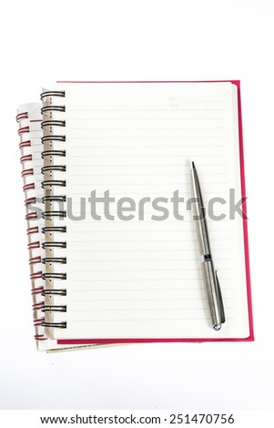 pen over note book - stock photo