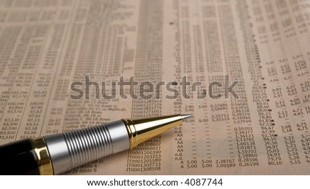 pen overdata on a financial  newspaper - stock photo