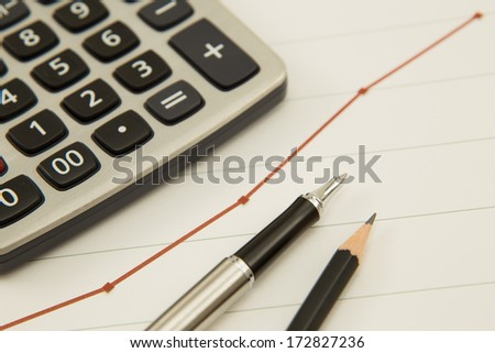 Pen showing diagram on financial report. Accounting - stock photo