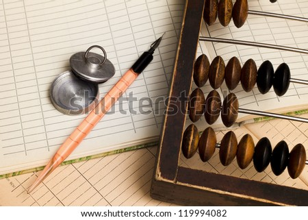 Pen, stamp and old abacus. - stock photo