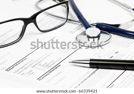 Pen stethoscope and glasses over blank Prescription form with patient and pharmacy information - stock photo