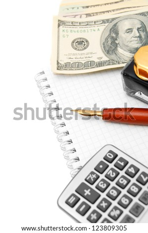 Pen, the calculator, dollars and a notebook.