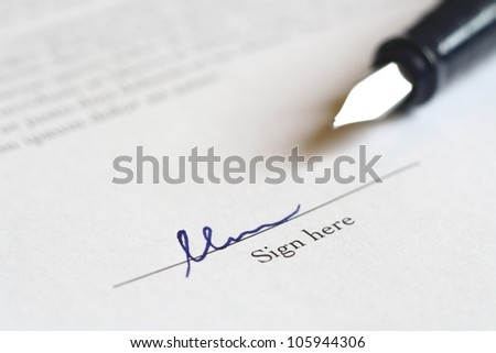 pen to sign a deal - stock photo
