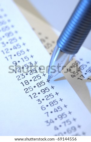 Pen with Calculator paper tape - stock photo