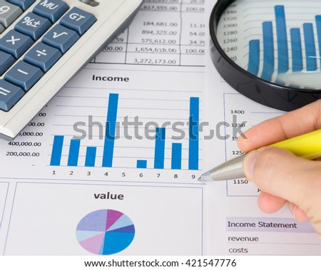 Pen with growth business analysis report, calculator on desk of business analyst. Concept of business, investment, business consultant service. - stock photo
